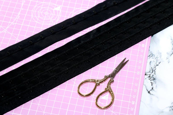 corsetry black hook and eye tape.