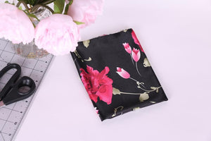 intense pink floral and black background satin charmeuse. Fabric for loungewear, lingerie and bra making.