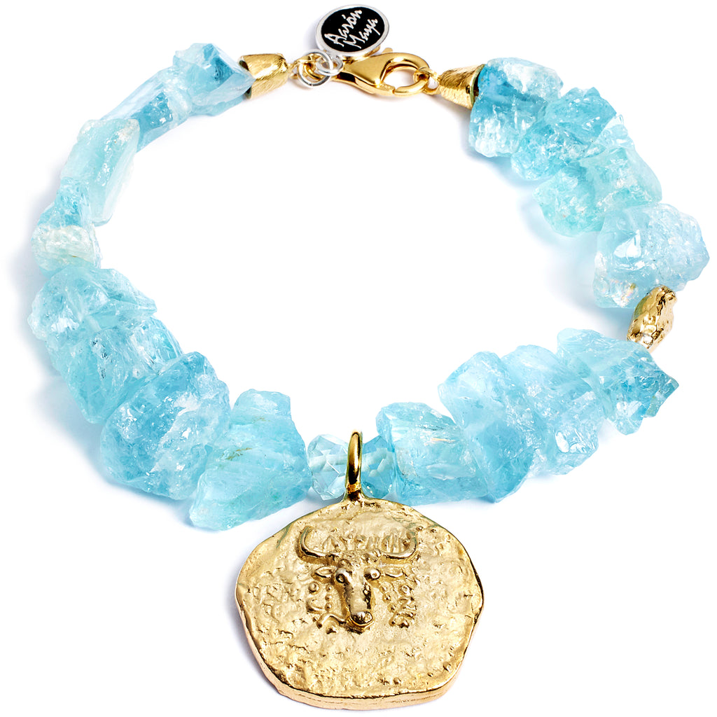 Unpolished aquamarine bracelet with antique coin reproduction