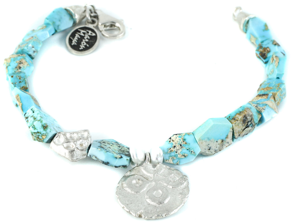 Turquoise bracelet and coin