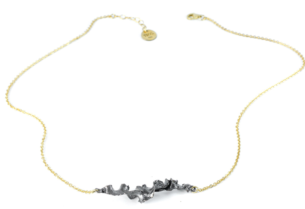 Gold and oxidized necklace