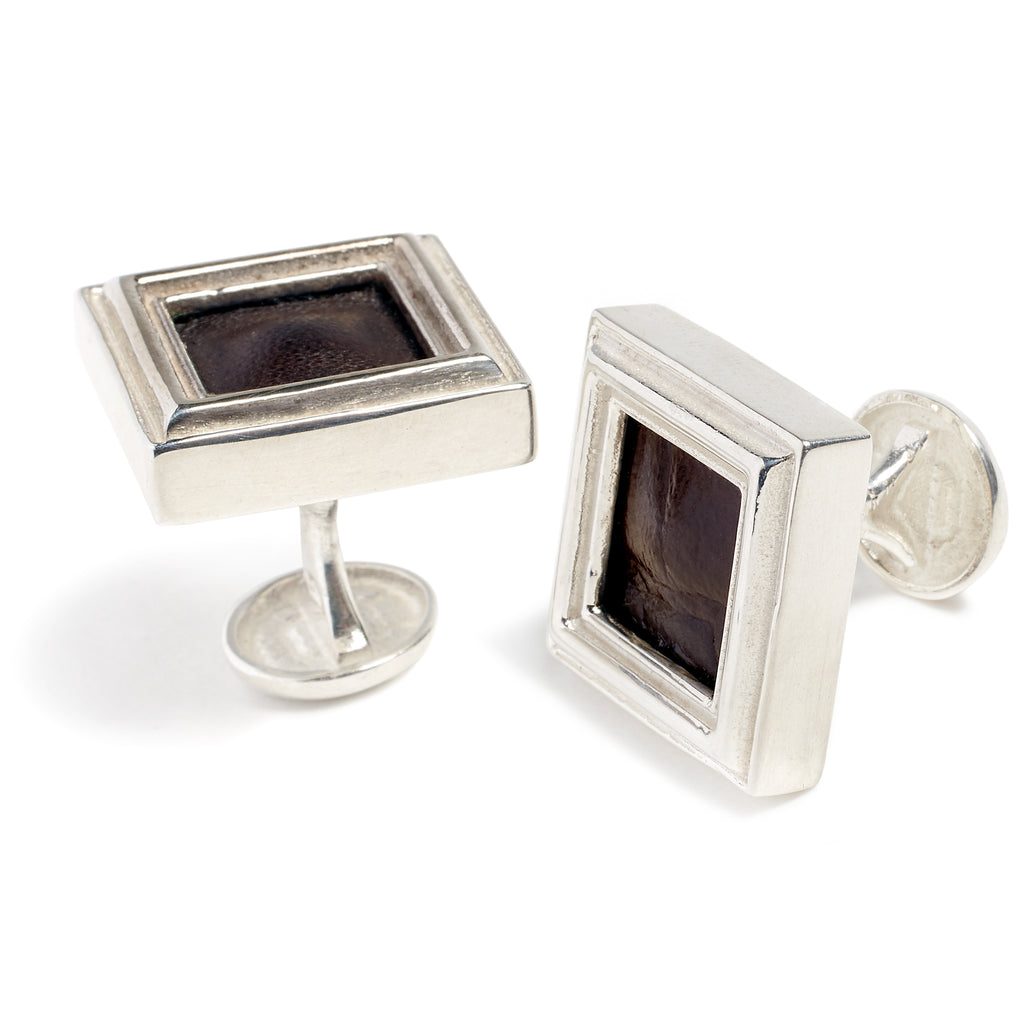 Silver and leather cufflink