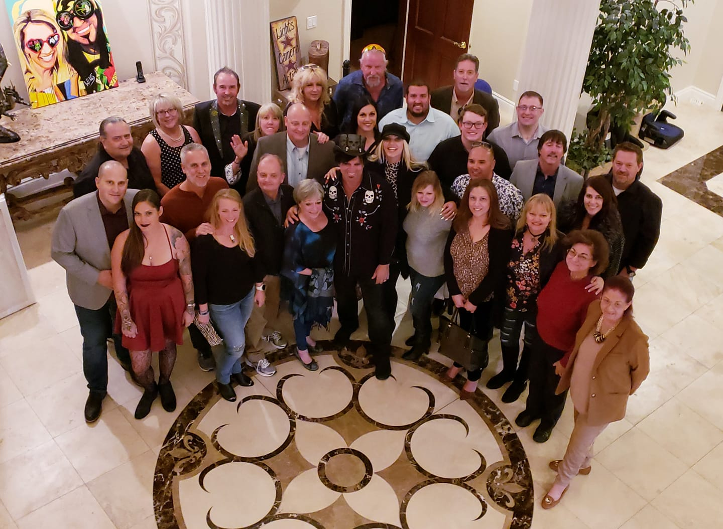 Photo of the artist Michael Godard with our VIP collectors at a Dinner with Godard event in Las Vegas