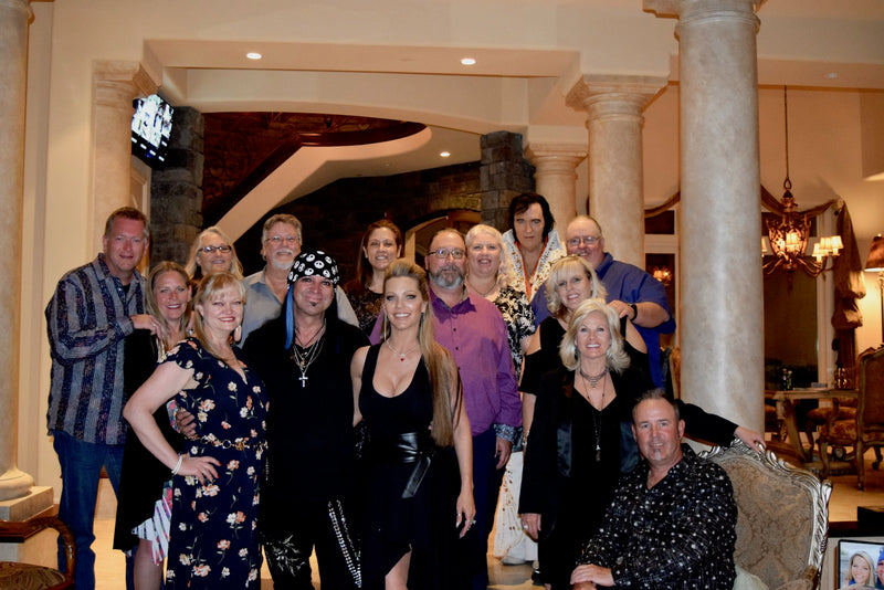 Group photo of Michael Godard and LeeAnn Godard at our VIP Dinner with Godard event in Las Vegas at their private home