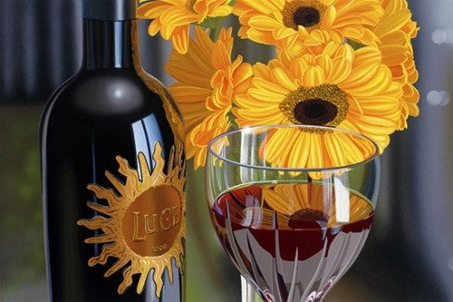Painting by Scott Jacobs of a bottle of wine with a sunshine shaped label next to a yellow flower and glass of red wine
