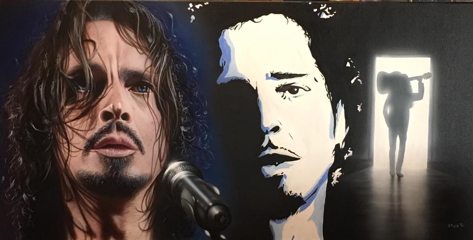 A blurred three-panel painting shows a realistic image of Chris Cornell on the left, with a blue aura and a microphone in front of him. In the middle is a black and white line sketch of Cornell, only showing the right side of his face. On the right is a full body shot of Cornell walking away, towards a lit doorway in an otherwise dark background, with a guitar resting on his shoulder.