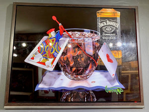 This is a mixed media on metal featuring a glass of Jack and Coke, sitting on a white and blue napkin. Inside the glass you'll find the hidden face of a woman. The Jack and Ace of hearts are present and the Jack is emerging out of the card and stirring the drink with a red stir stick. A bottle of Jack Daniels Tennessee Whiskey sits in the back ground.