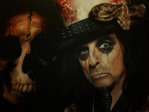 Alice Cooper is pictured holding a microphone. He is wearing black face paint around his eyes and a bloodstained-looking spiked top hat with a patterned large snake on the side of it. In the background on the left is a slightly faded cracked scull.
