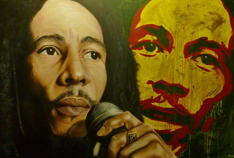 A close up of Bob Marley is pictured, looking towards the right with a microphone in his hand and a large ring on his middle finger. In the background is a red yellow, black, and red painting of him facing forwards.