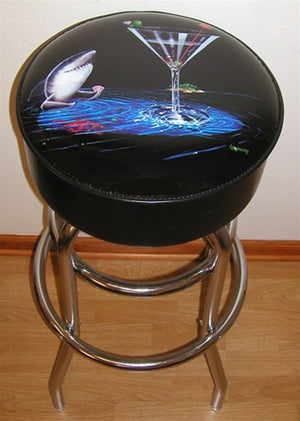 "Black background leather stool depicting a shark playing poker from the blue water below a martini glass. On the rim of the martini glass sits a green olive holding his own poker hand. A red sign inside the glass reads, ""Card Shark Poker Room"". Chrome plated legs and foot rest."
