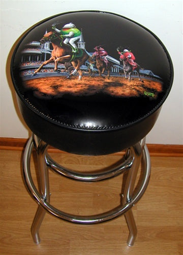 Black background leather bar stool depicting an olive, a strawberry and a grape riding three legged horses around a track. The olive holds a martini. The strawberry holds a glass of champagne. And the purple grape holds a glass of red wine. The stands are full of fans and the green olive is winning!