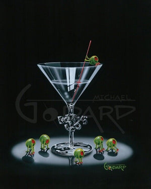 "A black background canvas. A martini glass with ""Bottoms Up"" carved into the stem. Surrounding the glass are five female green olives with their pimento ""bottoms"" int he air. A single famile olive is holding the stir stick on top of the glass."