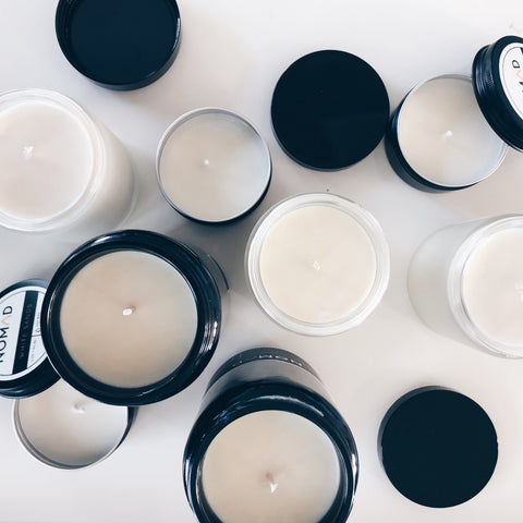 mix of Nomad Wax natural soy candles on white table