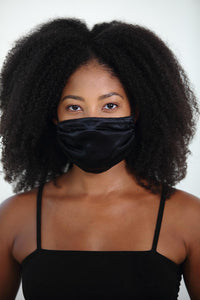 A Strong Woman Looks A Challenge In The Eye And Gives It A Wink Women's Face Mask