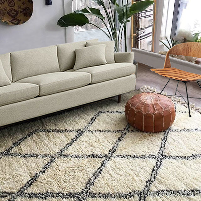 MOROCCAN HANDMADE RUGS Trendy and classy handmade Moroccan Rugs, made by the Berber tribes from the Atlas Mountains in Morocco. This rugs are handmade, double-knotted and naturally dyed 100% natural wool carpet made in Morocco.