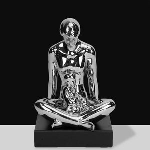 Silver Ceramic Cross-Legged Man with Child Figurine