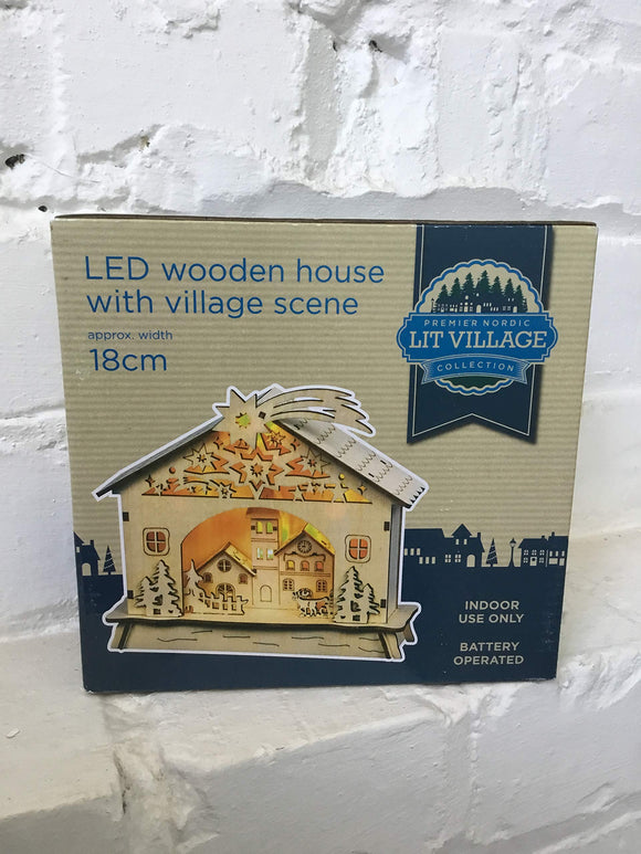 Premier 18cm LED wooden house with village scene, battery operated