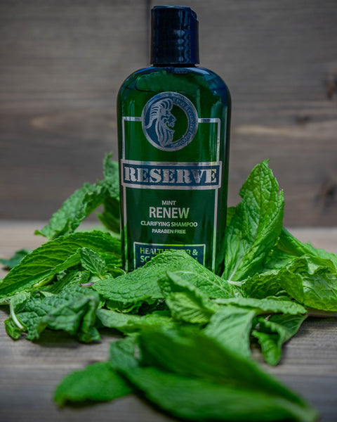 King & Country Grooming's RESERVE Clarifying Mint Shampoo sits on a bed of fresh mint - Made in Vancouver