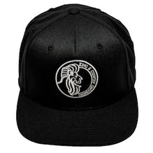 Load image into Gallery viewer, All black snapback hat for men and women embroidered in Vancouver, BC, Canada with the King & Country Grooming Lion logo.