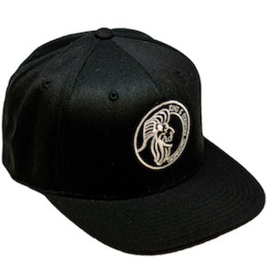 All black snapback hat for men and women embroidered in Vancouver, BC, Canada with the King & Country Grooming Lion logo.