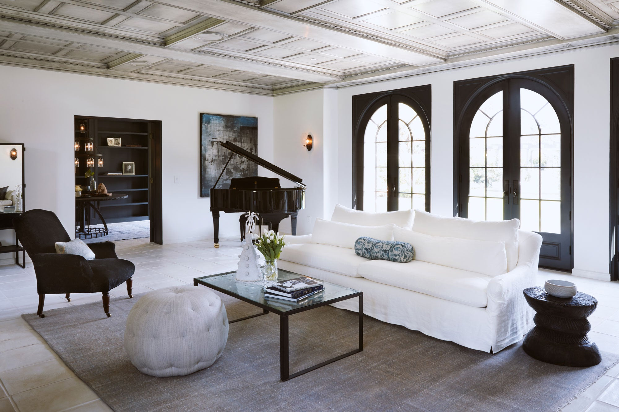 living room with white sofa, lounge chair and grand piano