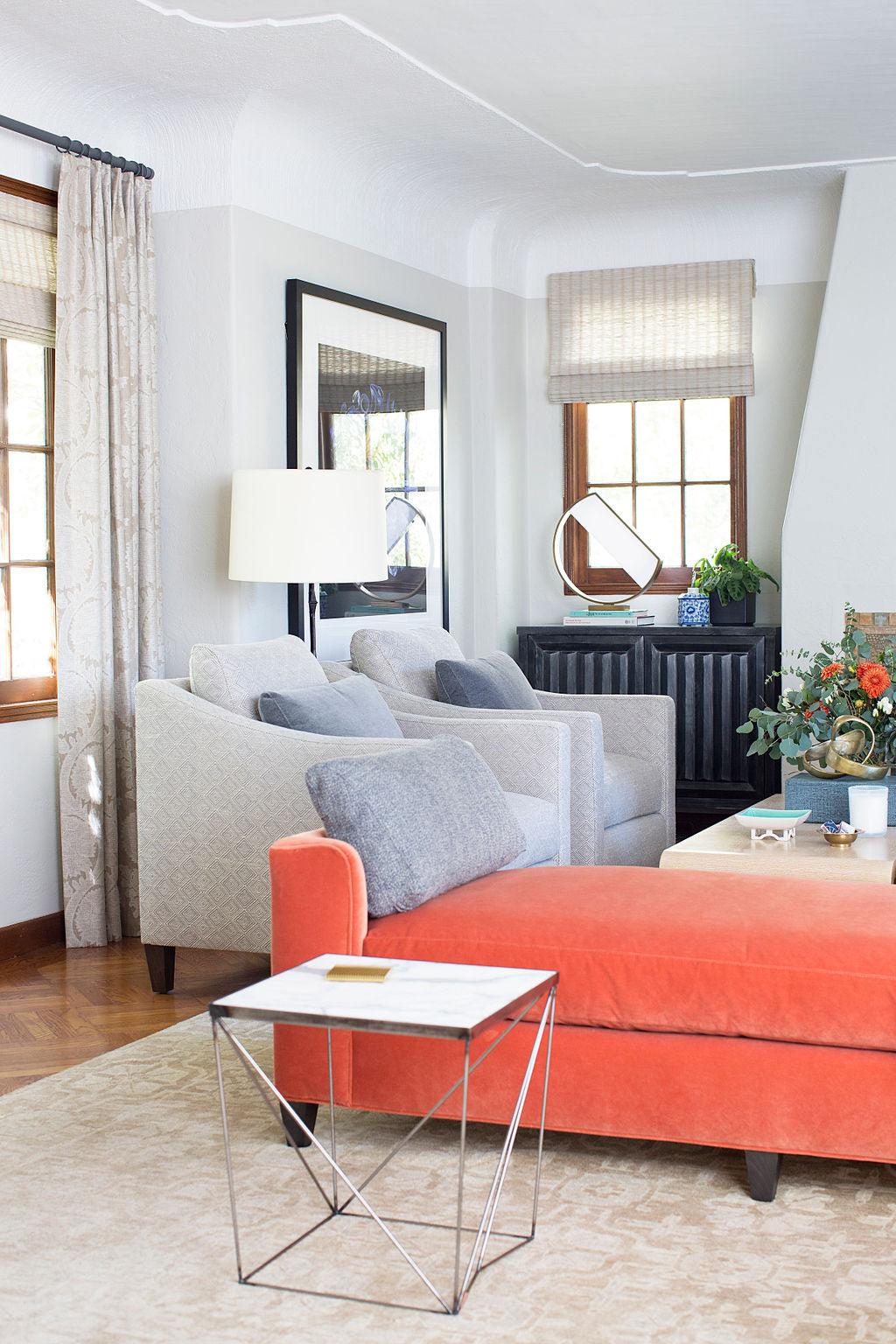 interior featuring two grey lounge chairs and salmon colored day bed