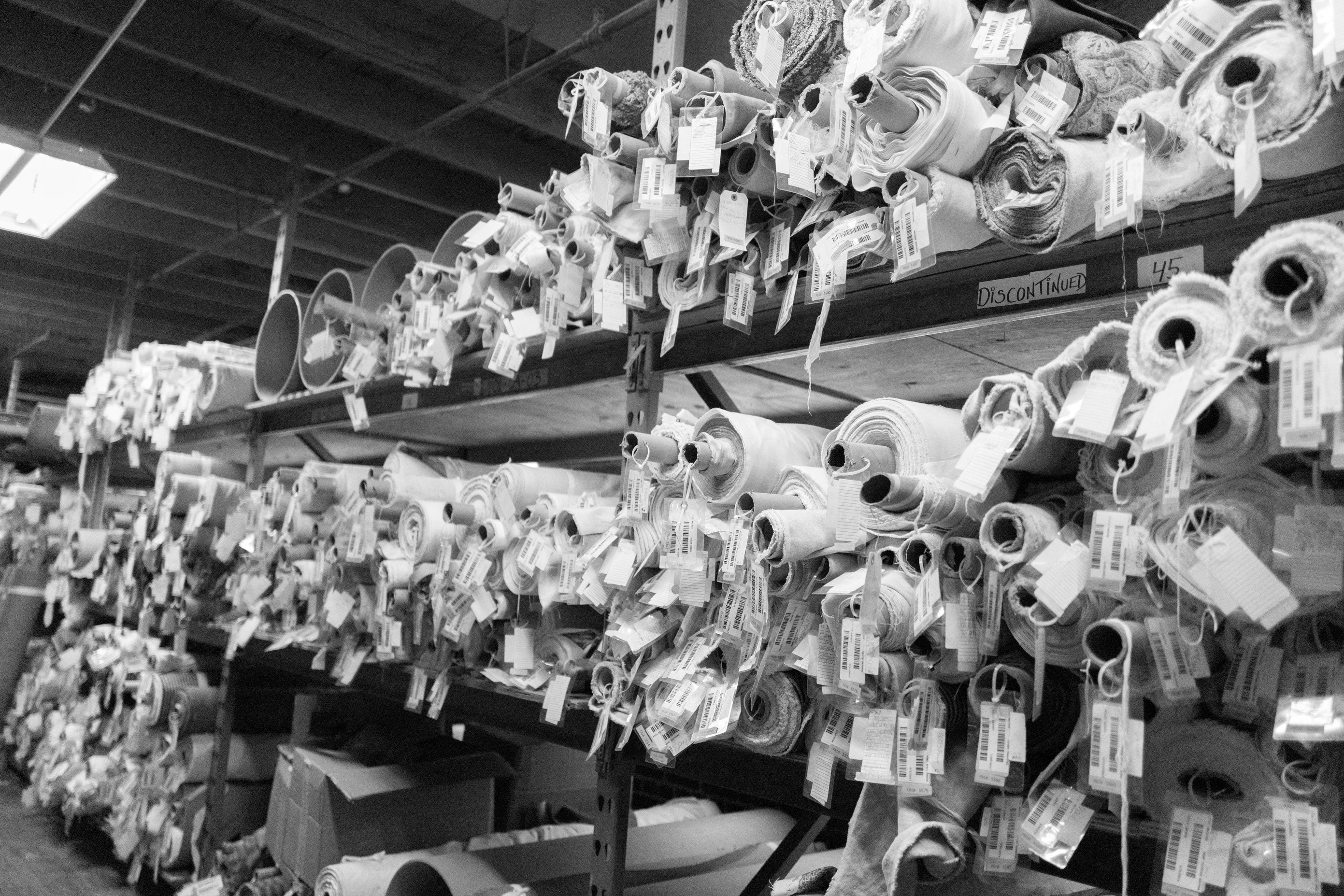 black and white image of fabric on rolls