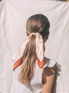 How To Stop A Silk Scarf Slipping In Your Hair