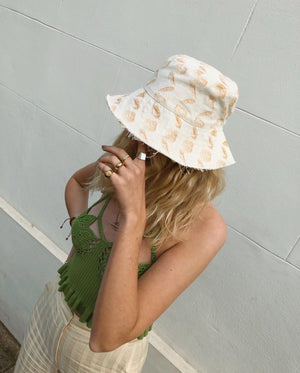 Paige Leanne @paileaa in Lio Mara Linen Bucket Hat, Dark Orange, Shell Print Sun Hat, Summer Hats For The City