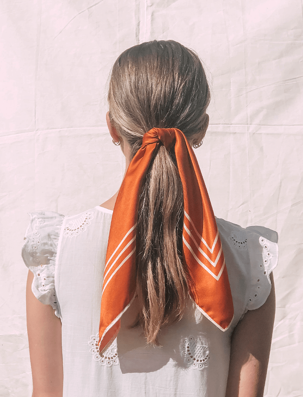 Lio Mara Classic Orange Silk Tencel Sustainable Scarf UK Worn Round Ponytail