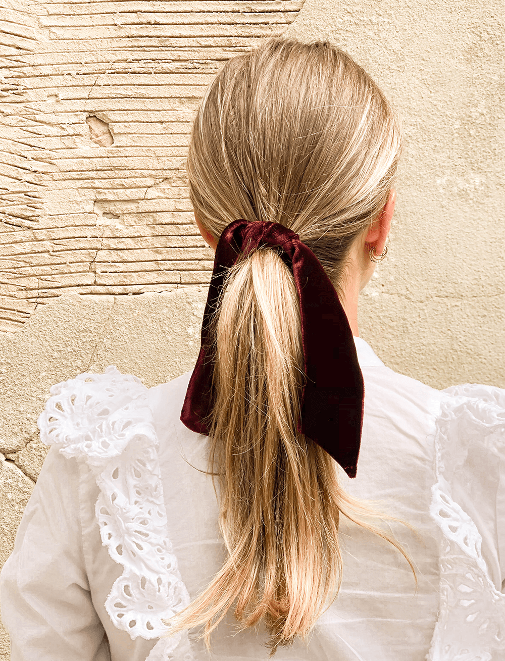Lio Mara Maroon Silk Velvet Hair Tie For Ponytail Worn With White Shirt