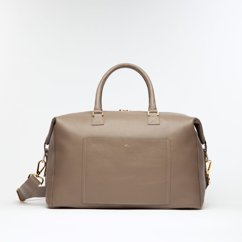 "Taupe Weekend Travel Bag made of Italian leather with gold hardware. Dimension: 18.5"" L x 11.5"" H x 8.5"" D. Made in Spain"