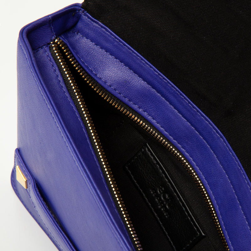 "Italian leather clutch bag in cobalt blue. Dimension: 10"" L x 7.5"" H x 2"" D (Top). featuring studs and perforated top flap."