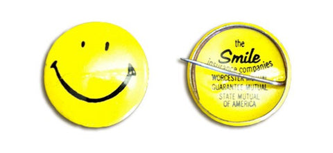 Smiley pin for insurance company by Harvey Ball