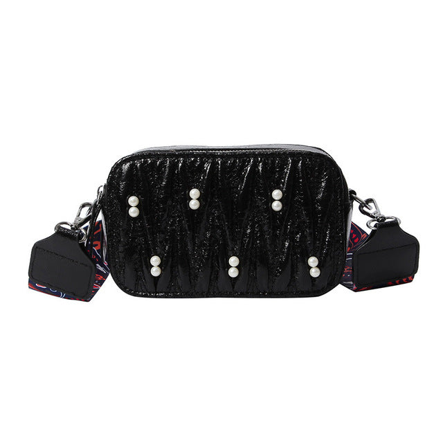 Pleated clutches bag with beading