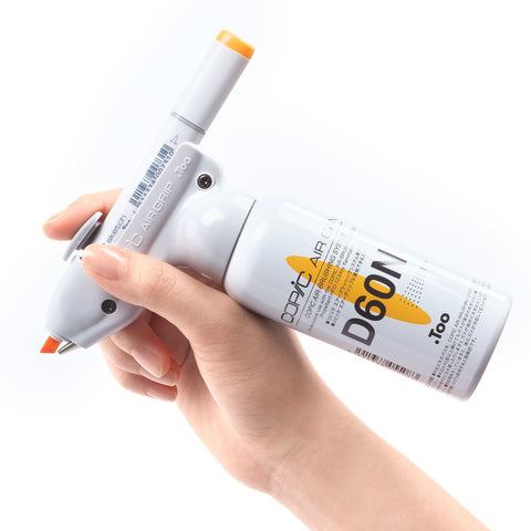 Hand holding AirBrush System with sketch marker, Air Grip, and Air Can D60N.