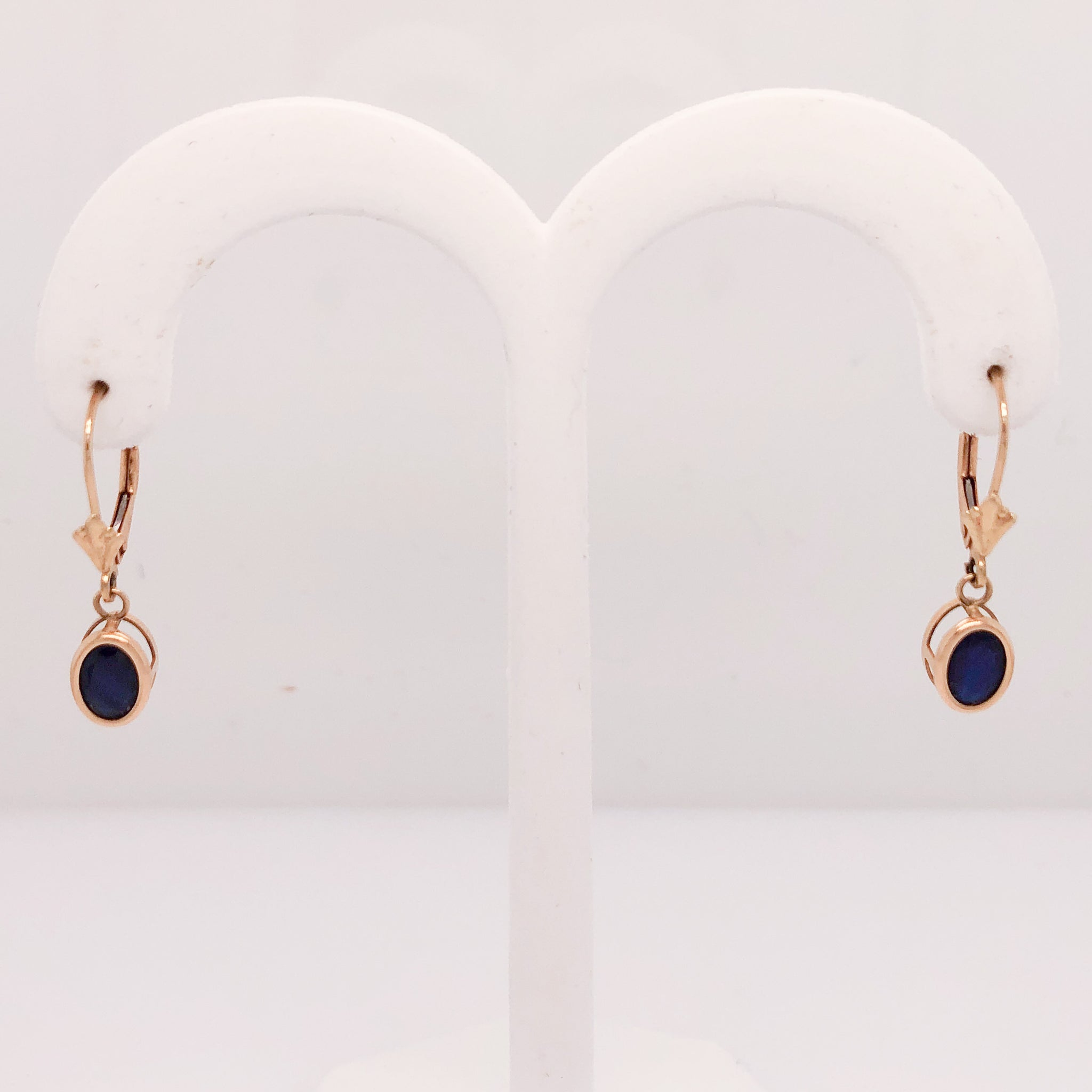 14K Yellow Gold Lever Back Earrings with Oval Bezel Set Blue Stones (Believed to be Sapphires)  CE0118