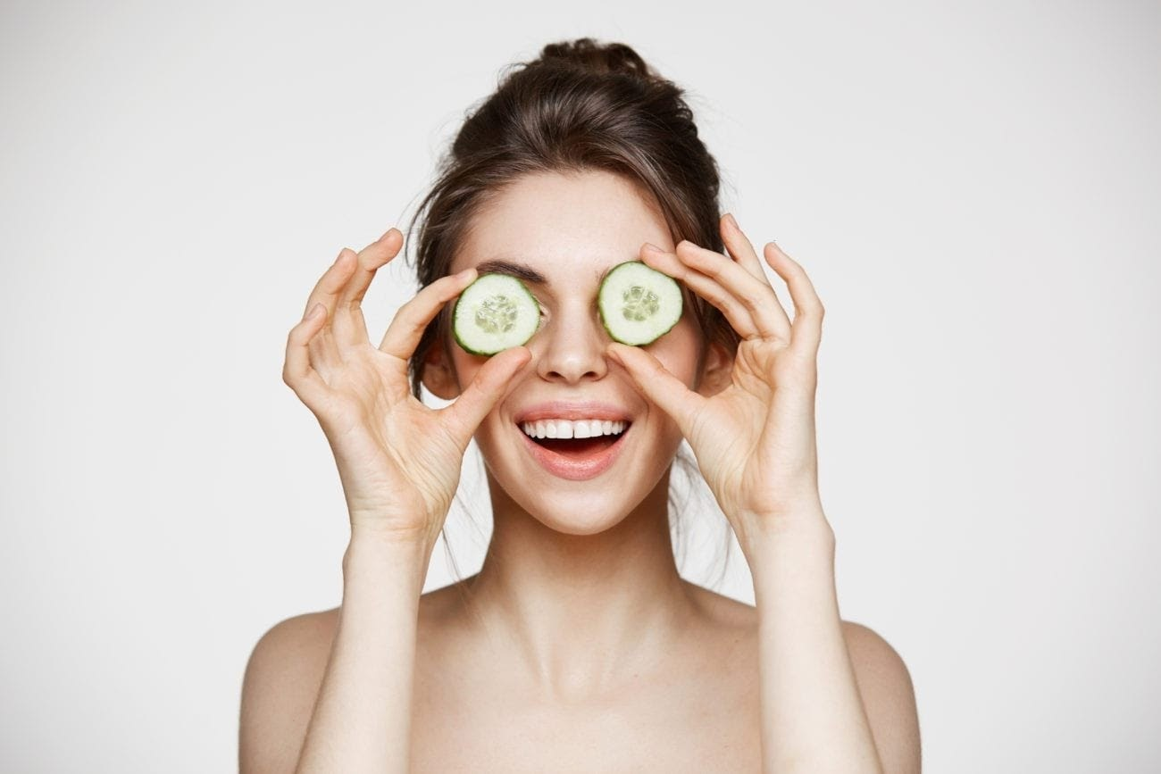 Vegan Skincare Woman With Cucumber on eyes