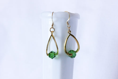Curvy earrings - gold with forest green crystal
