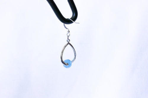 Curvy earrings - silver with sky blue crystals