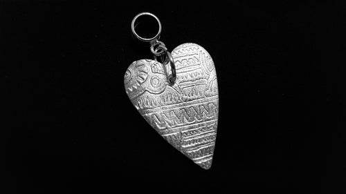 Tattooed on my heart .999 fine silver pendant