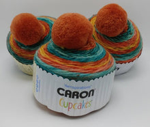Load image into Gallery viewer, MANGO TANGO Caron Cupcakes with a Pom Pom Yarn by Yarnspirations - 3oz / 244 yards Acrylic Self-Striping - Orange, Blue-Greens, & Golden