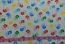"Load image into Gallery viewer, FLANNEL FABRIC Sold By-The-Yard ~ Primary Colored Childrens Handprints on White Background - Cotton - 45"" Wide - Great for Rag Blankets"