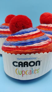 CHERRY ON TOP Caron Cupcakes with a Pom Pom Yarn by Yarnspirations - 3oz / 244 yards Acrylic Self-Striping - All American Red, White, Blue
