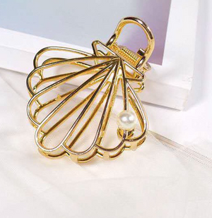 Gold shell with pearl clip