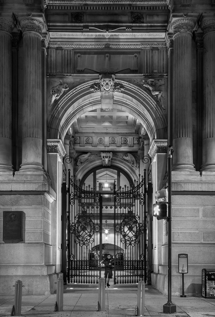 """East Portal to City Hall, Philadelphia"" by James Abbott. An Inkjet Print depicting the intricate wrought-iron gate surrounded by the monumental archway leading into the interior courtyard of Philadelphia's City Hall. The Print Center"