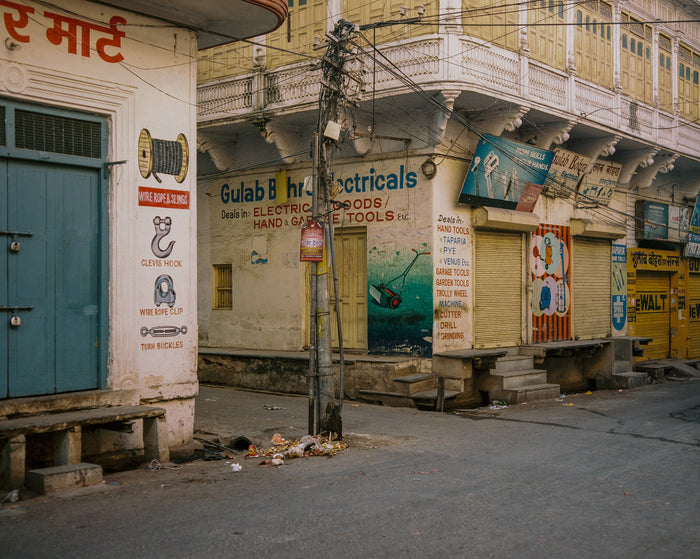 """Gulab Bohra Electricals"" by Saleem Ahmed. An Inkjet Print depicting a series of closed shops. Photography, Color, Cityscapes, Urban Landscapes. The Print Center"