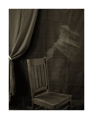Empty Chair with the Limb of an Unidentified Spirit