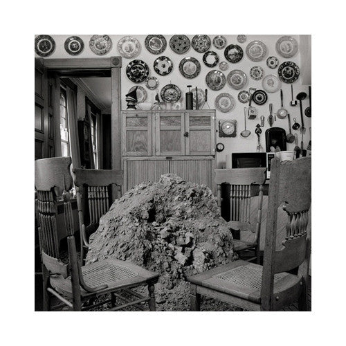 Kitchen Keith Sharo Geltain Silver Print the print center black and white kitchen chairs pile of dirt table plates hung on wall family histories