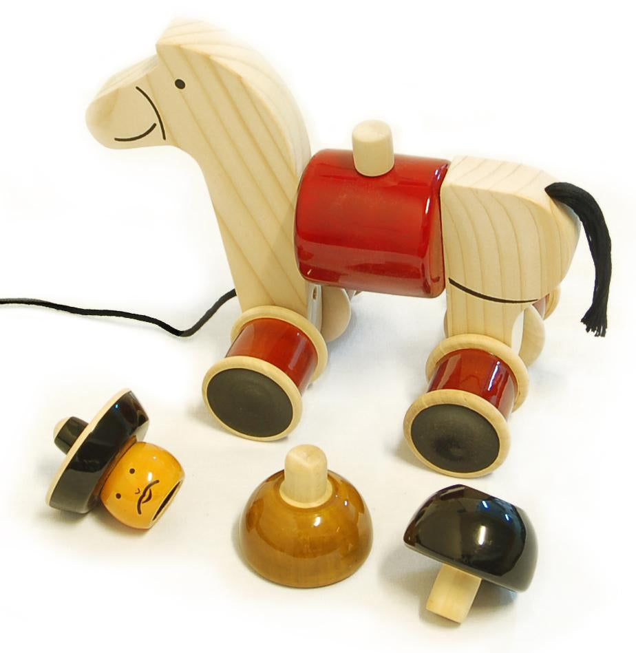 hand-crafted wooden cowboy pull toy